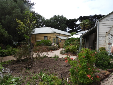 Looking at the back of the house from the herb and vegetable garden